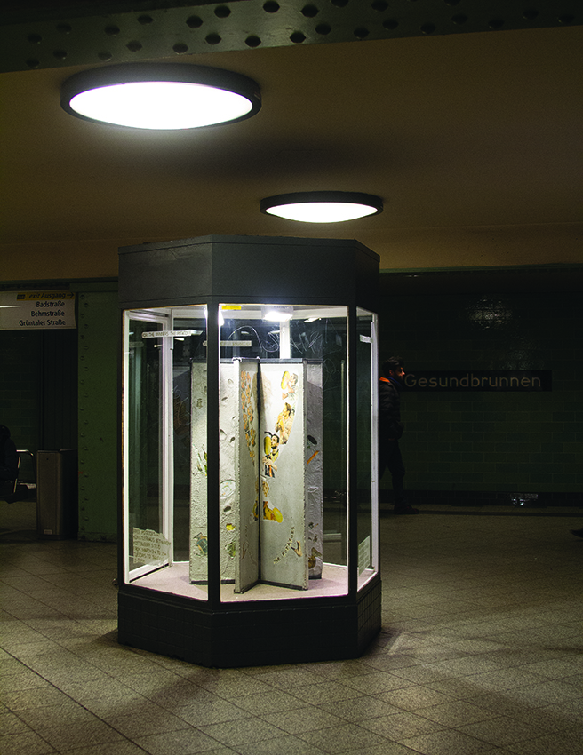 Matheus Rocha Pitta, <i>Column # 1 (potato podium)</i>, 2016/2017, metal structure, concrete, paper and removed potatoes, 130 x 36 x 4 cm each, six concrete slabs, installation view at Gesundbrunnen U8 underground station. Ph. Eric Tschernow
