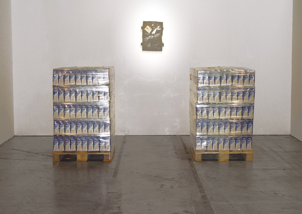 Mathues Rocha Pitta, <i>Giudizio universale</i>, 2012, 750 liters of milk, with expiring date 11.11.12,  last day of the fair, 120 x 115 x 80 cm each pile
